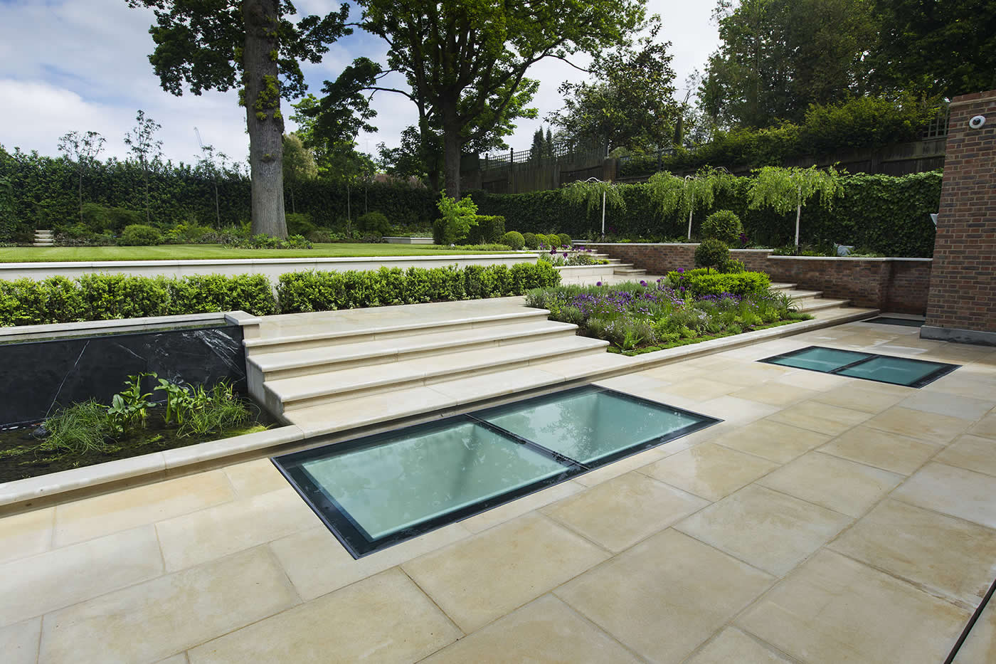 Contemporary Landscape Garden with stone in London