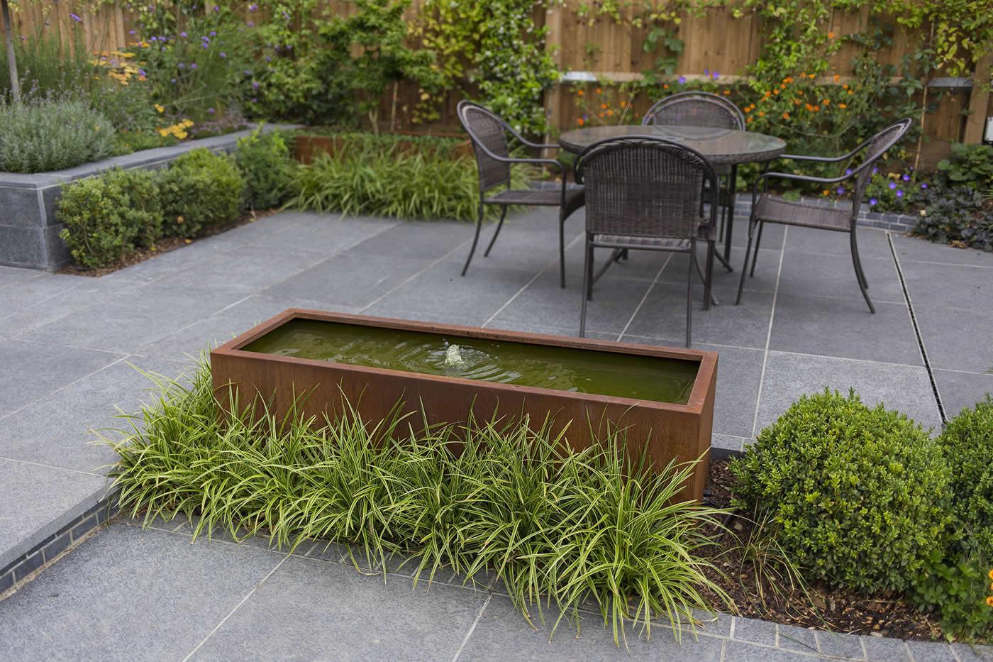 Family garden living space designed with informal for Informal garden designs