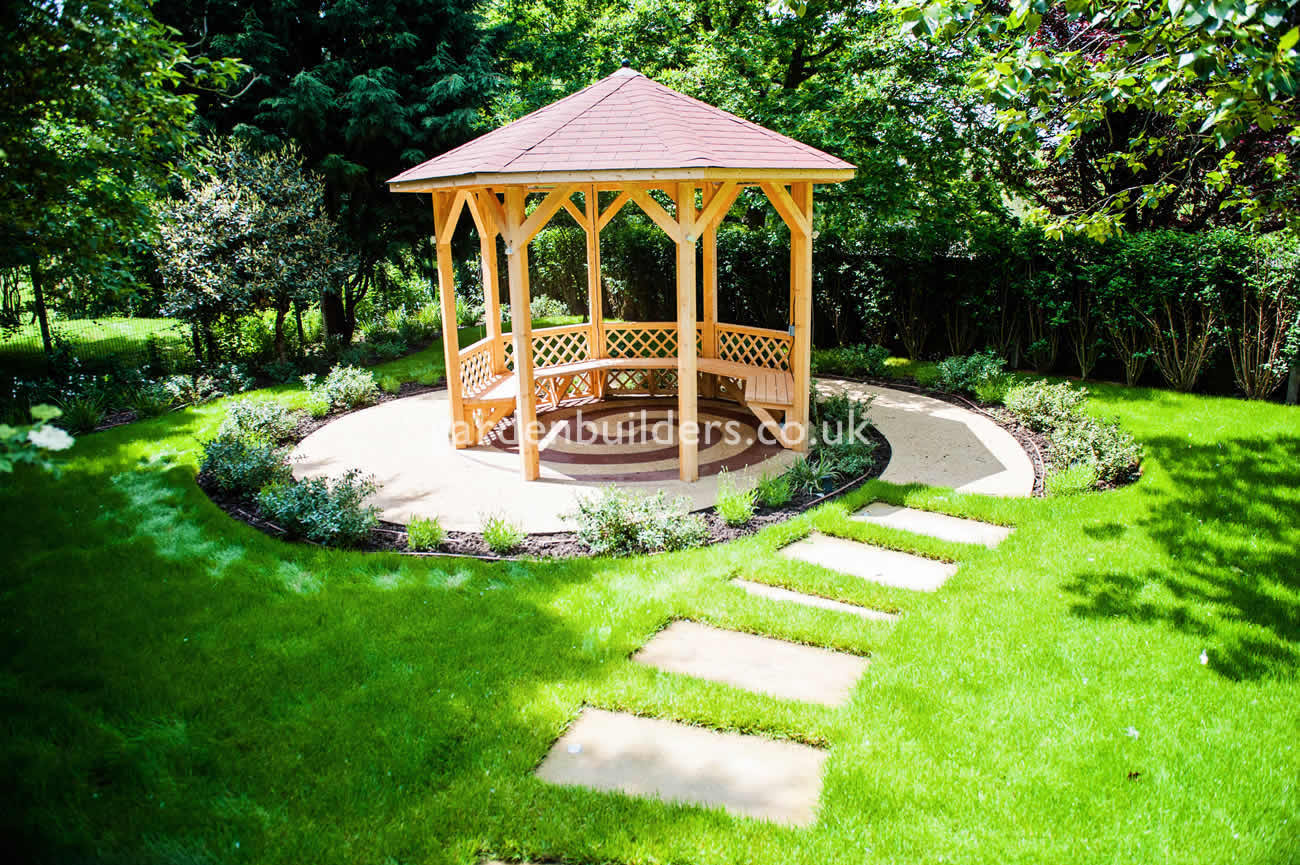 Large suburban garden desigened with york stone terrace for Terrace gazebo