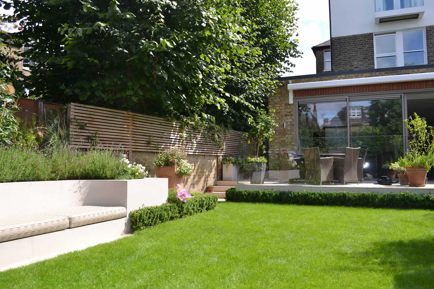 Lovely Low Maintenance Family Garden With Raised Bed For