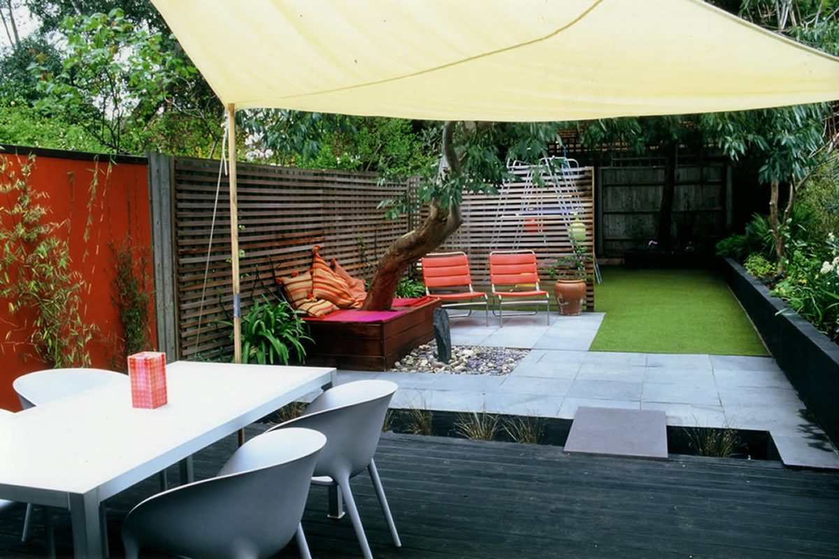 child friendly synthetic lawn designed as a low maintenance contemporary and colourful space - Garden Design Child Friendly