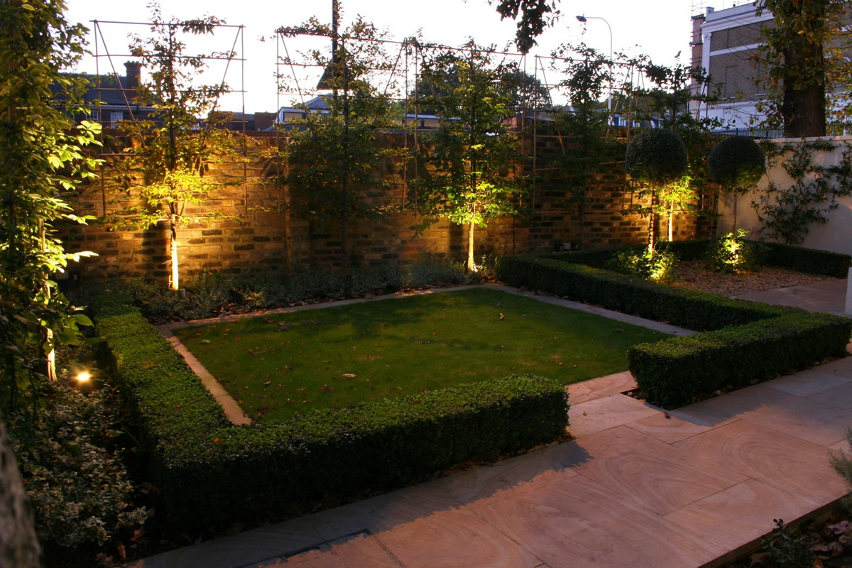 Contemporary garden with formal planting design and resin bonded grave