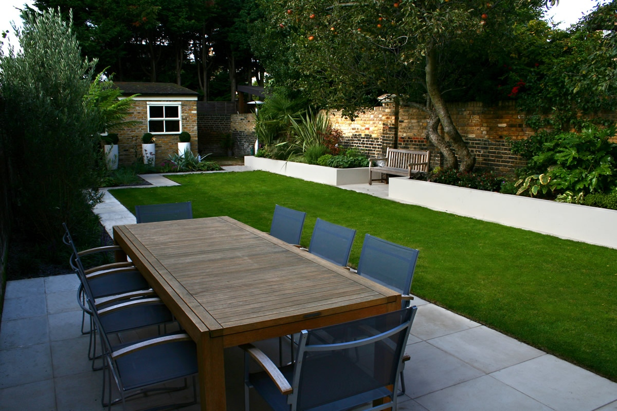 Modern family garden in battersea with patio lighting planting for Garden design company
