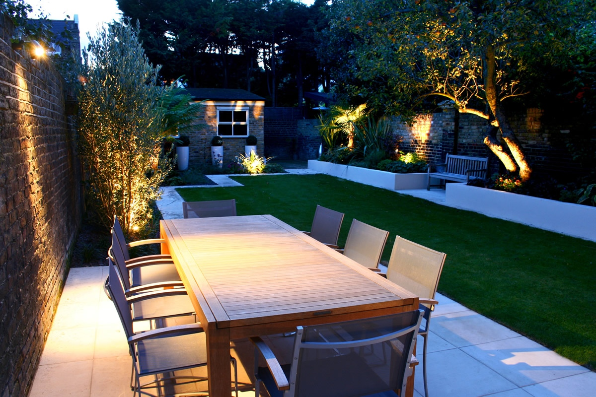 Modern family garden in battersea with patio lighting planting for Garden designs uk