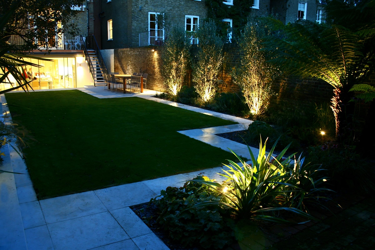 Modern family garden in battersea with patio lighting planting for Garden lighting designs
