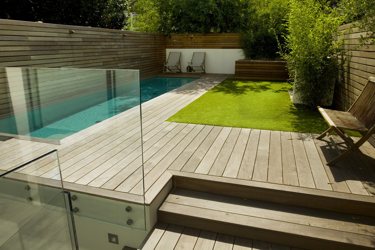 Lane swimming pool and contemporary garden designed and built by