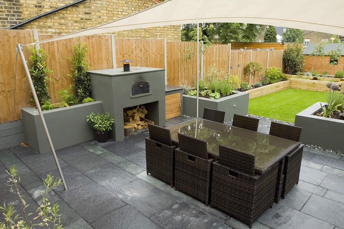 Wimbledon family garden design with formal dining terrace for New build garden designs