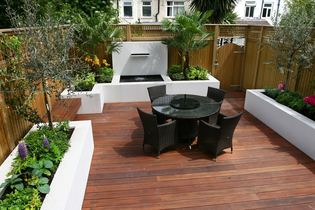 Small garden wimbledon designed with automatic irrigation for Garden decking designs pictures