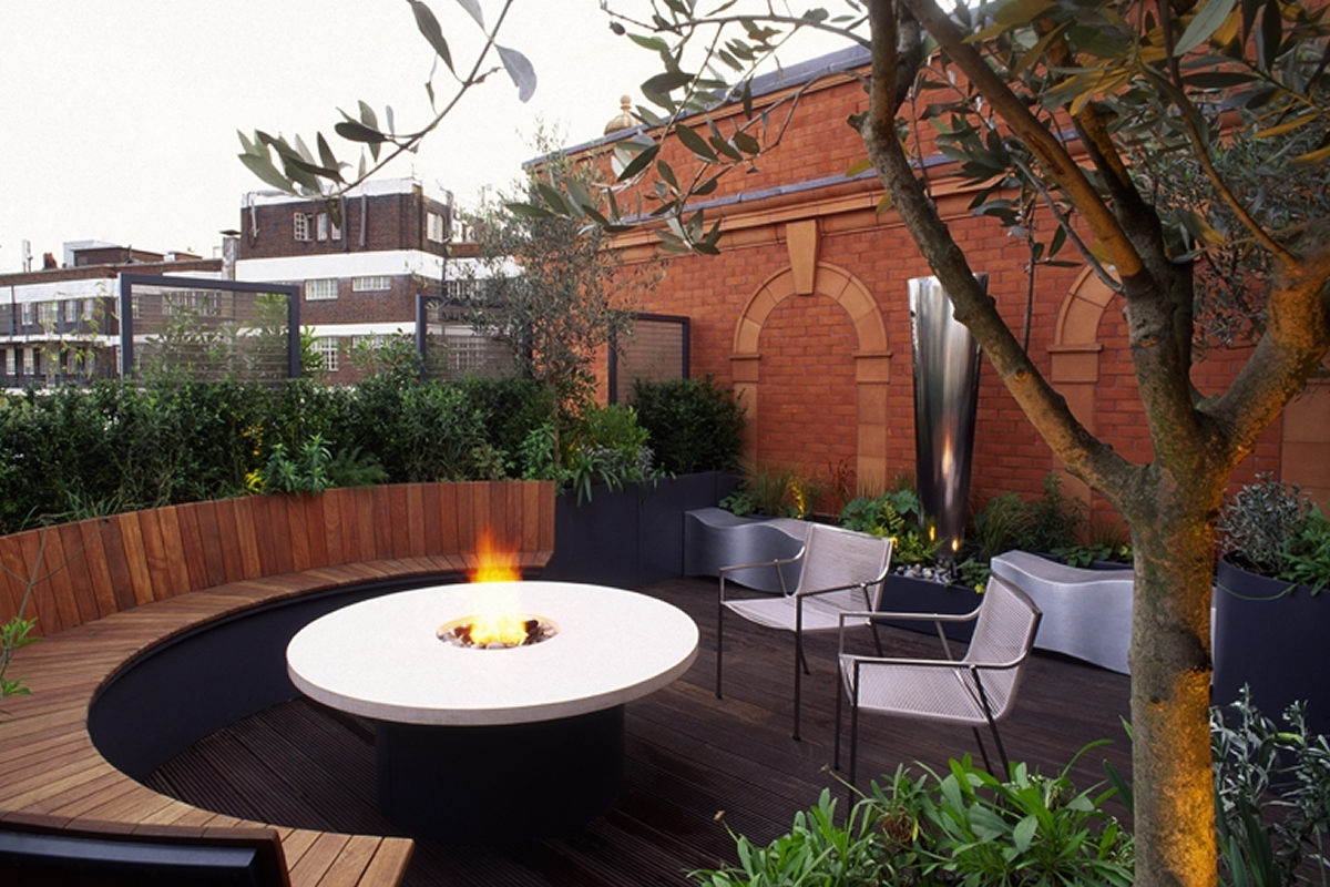 roof terrace knightsbridge designed with limestone circular table