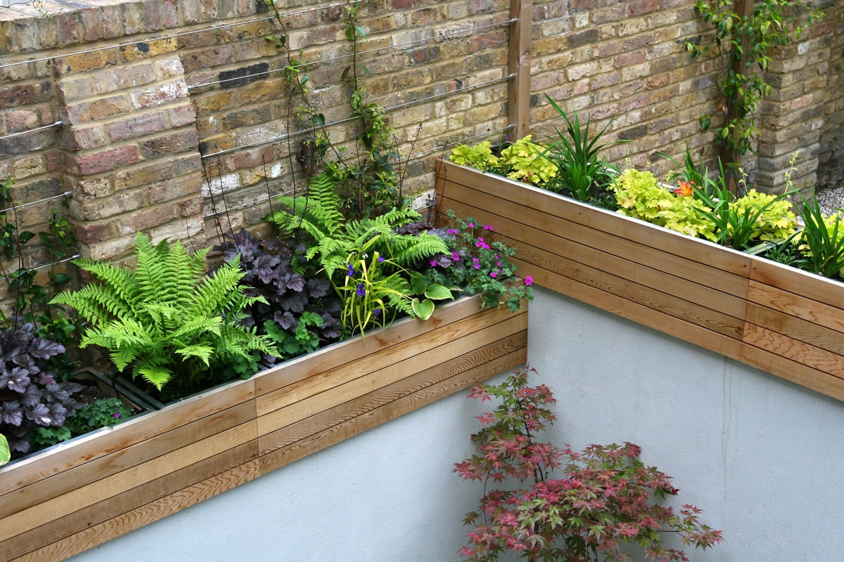 Gravel Small Town Garden With Beautiful Water Feature Planters With H
