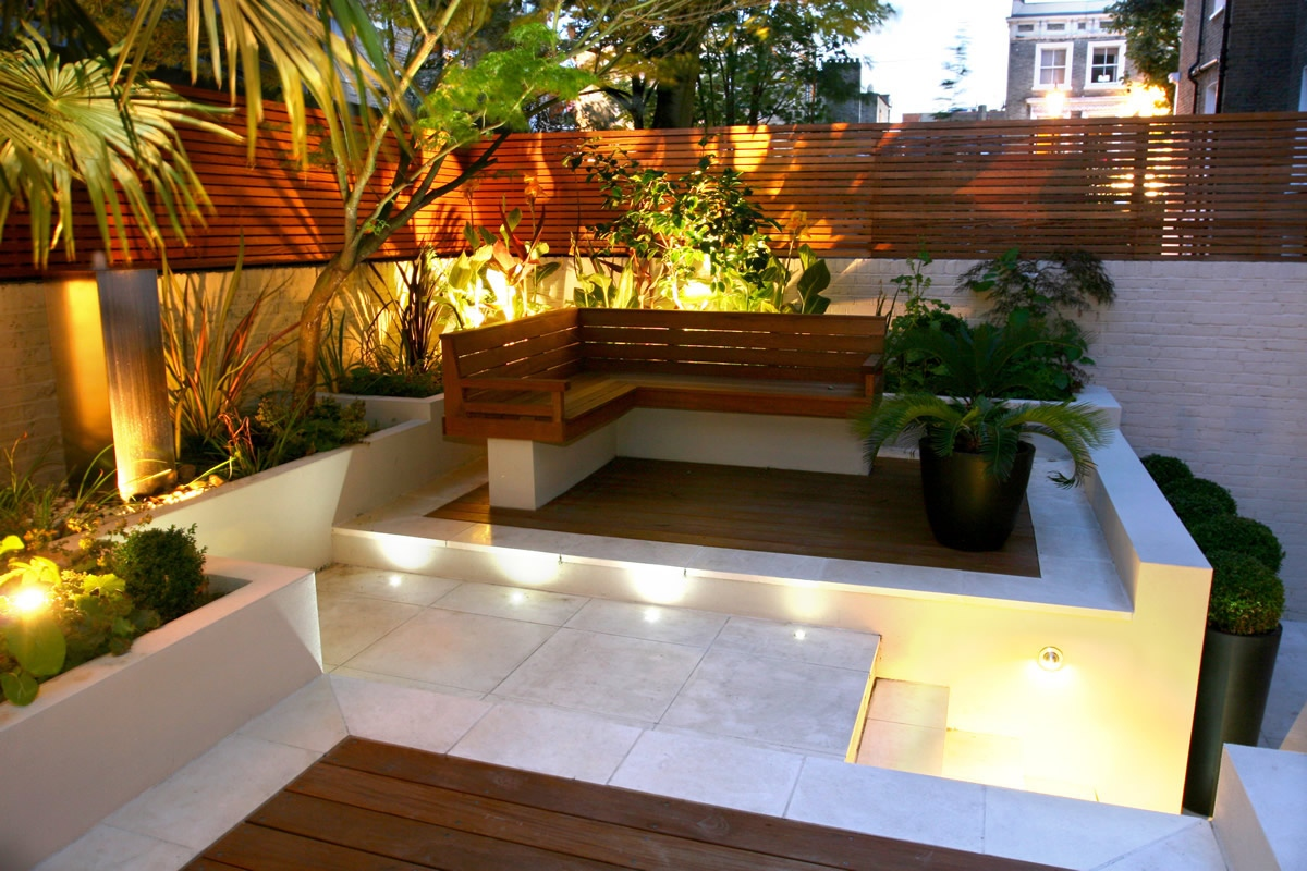 Contemporary Chic Garden, Slatted Hardwood Trellis By Ben Molyneux, Led  Lighting And Neat Limestone